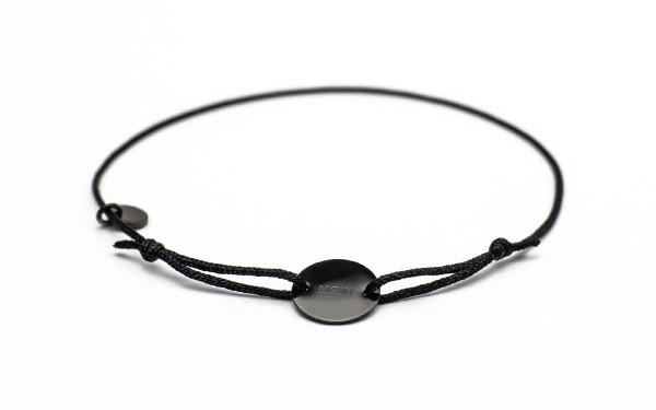 Armband mit Token MOIN schwarz schwarz bird frontansicht 600x375 - Token Armband MOIN in schwarz