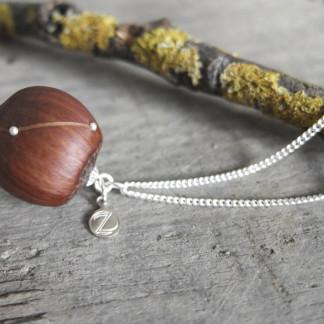 Haselnuss Halskette Sternzeichen Widder 1 von 2 324x324 - Sternklare Haselnuss-Halskette – Widder
