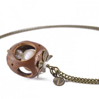 Lochmuster Haselnuss Halskette mit Suesswasserperlen in Bronze 1 324x324 - Lochmuster Haselnuss-Halskette mit Süßwasserperlen in Bronze